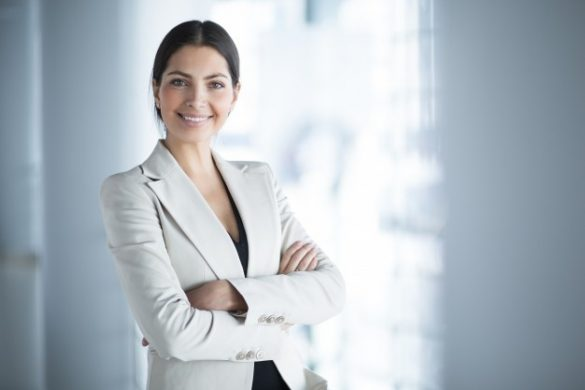 uc_smiling-female-business-leader-with-arms